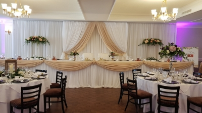 Leanne Elegance Backdrop with added Gold Brentmore Stands & Florals on the sides