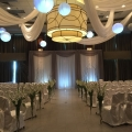Whimsical White Swags paired with Paper Lanterns with LED Lighting