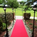 Red Carpet Entrance Way with Black Street Lamps