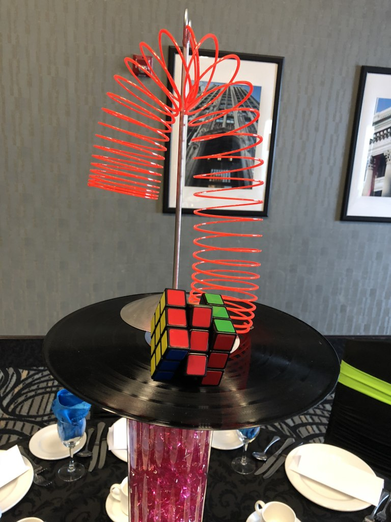 Custom Centerpieces - Slinkies, Rubik's cubes, records