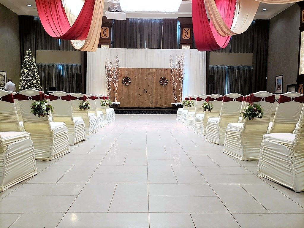 Christmas Wedding Ceremony with our Barn Doors and Ivory Wall of Sheer Backdrop
