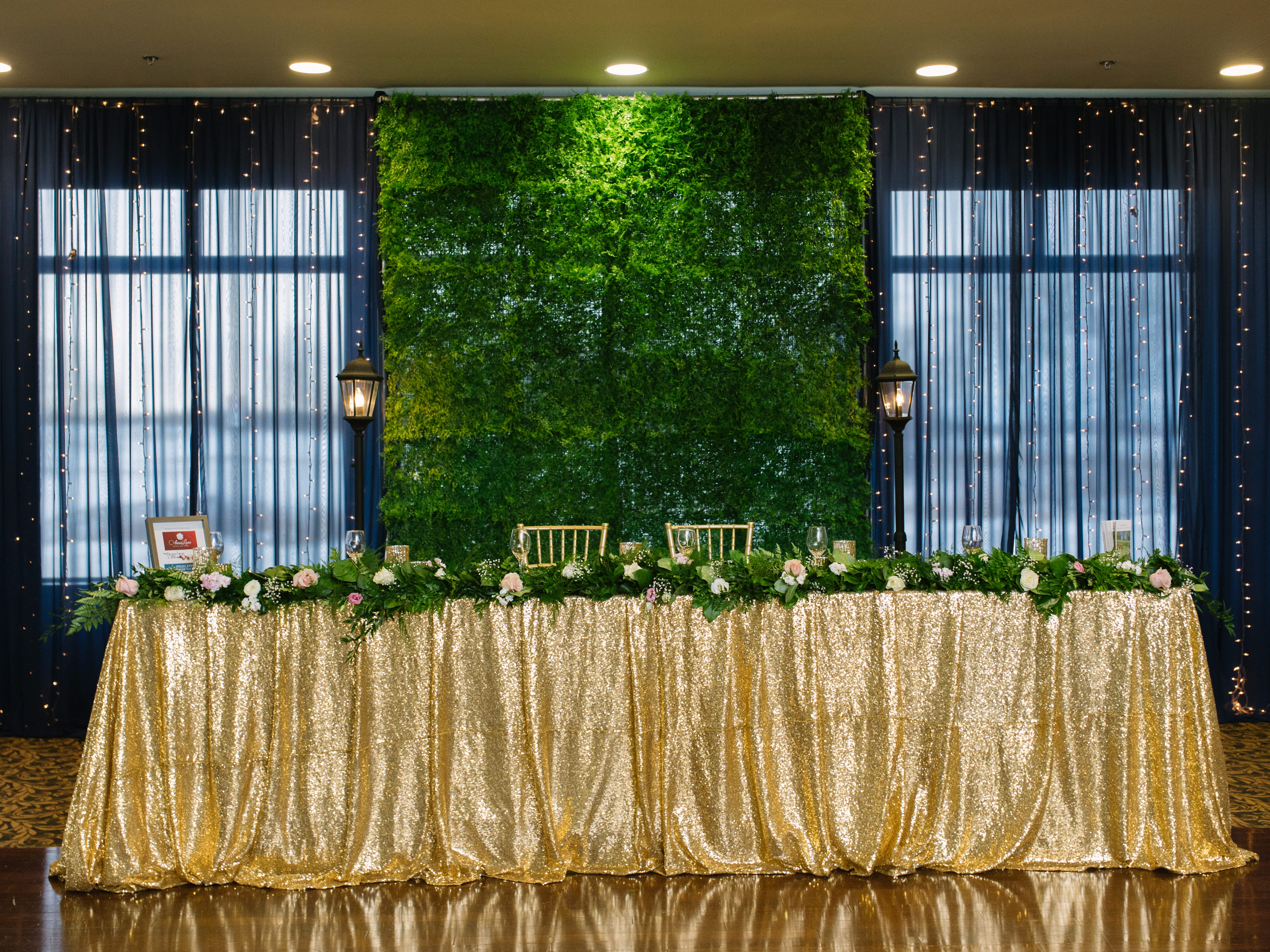 Faux Green Wall Backdrop with Navy Blue Waterfall of Lights & Street Lamps