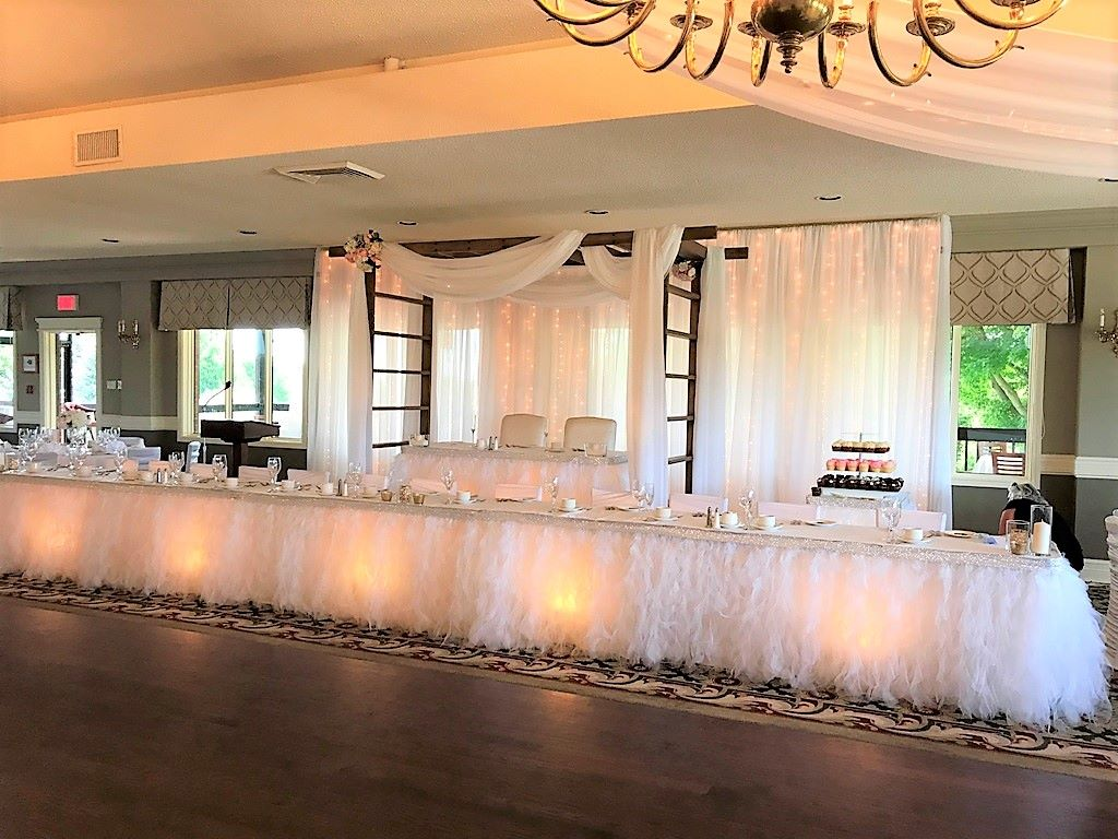 Trellis Over Head Table & Waterfall of Lights Backdrop