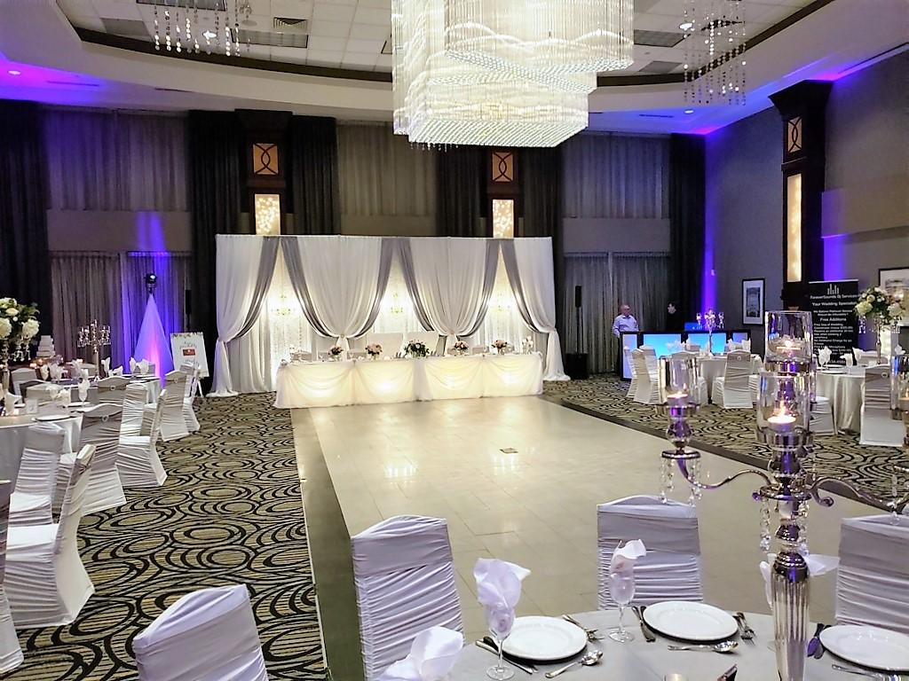 Vertical Drape Backdrop in White & Silver with Lace Panels & Chandeliers