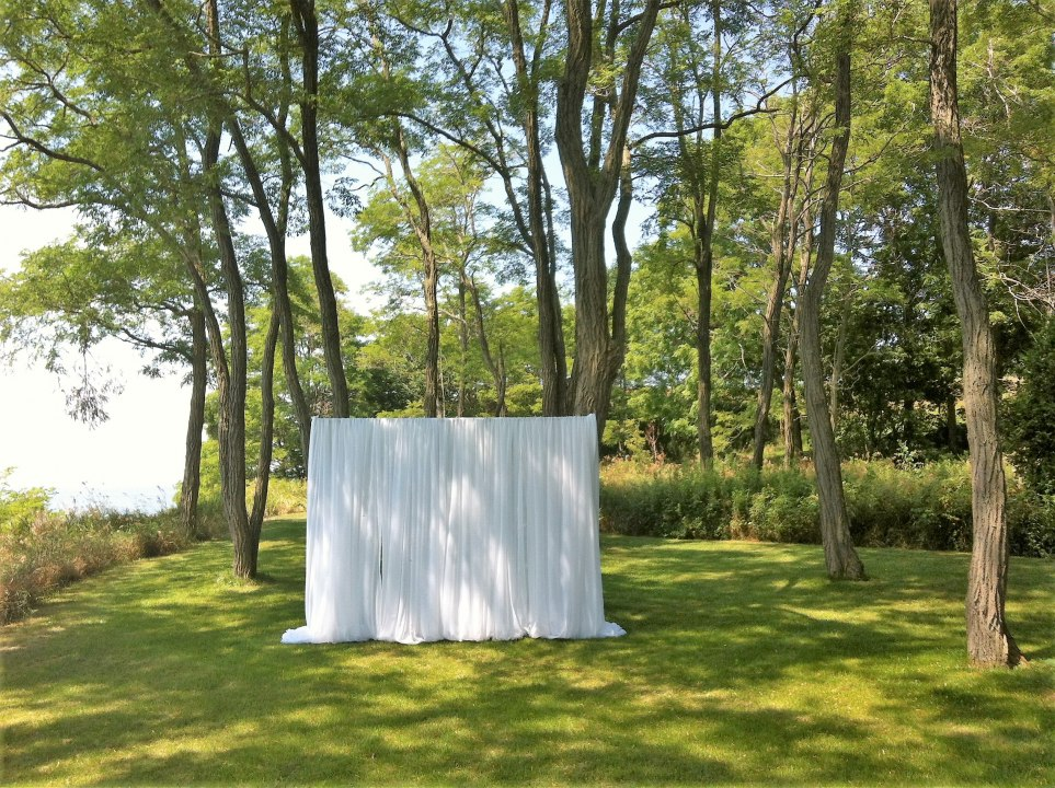 Simple Outdoor Ceremony Backdrop in White Sheer