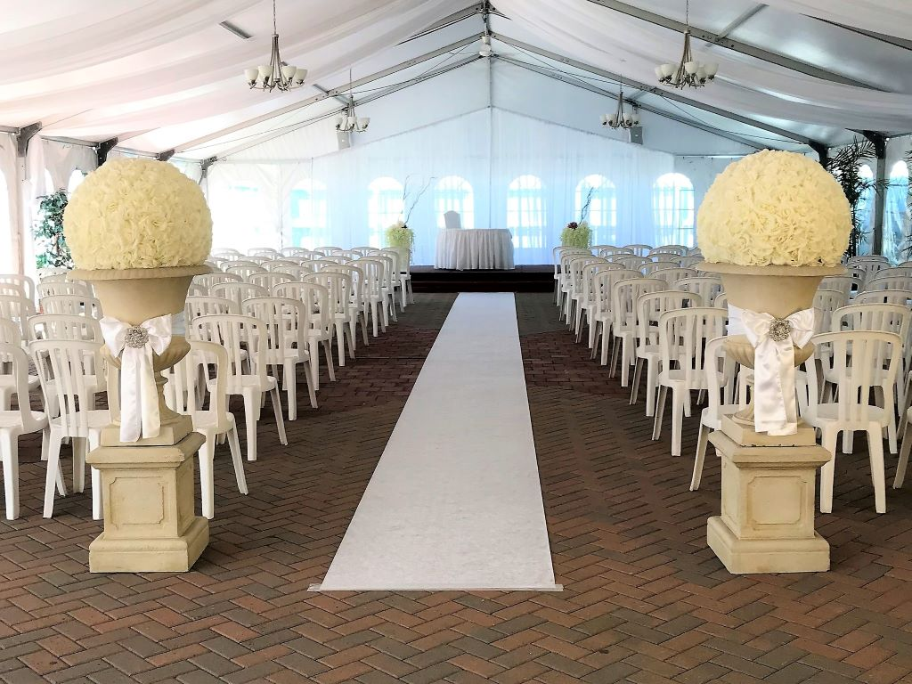 Stone Urns & Pedestals with Rose Balls for your aisleway entrance, Tosca Tent