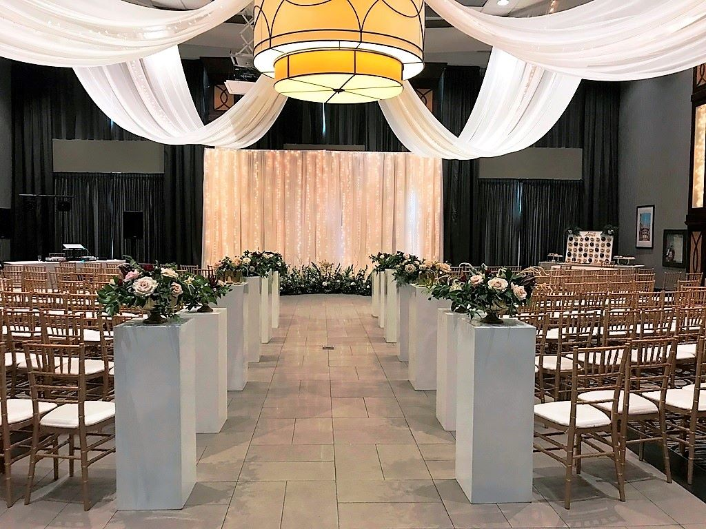 Ceremony Decor with White Cube Pedestal Aisle & Waterfall of Lights Backrop