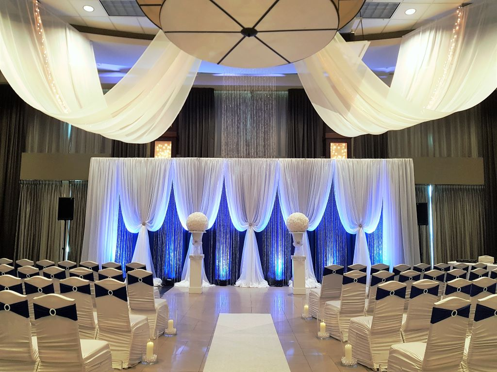 Ceremony Decor with 30' Vertical Drape Backdrop, White Urns & Pedestals