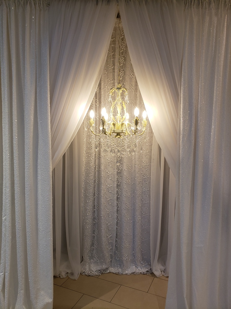 White Custom Entranceway with Heritage Chandelier