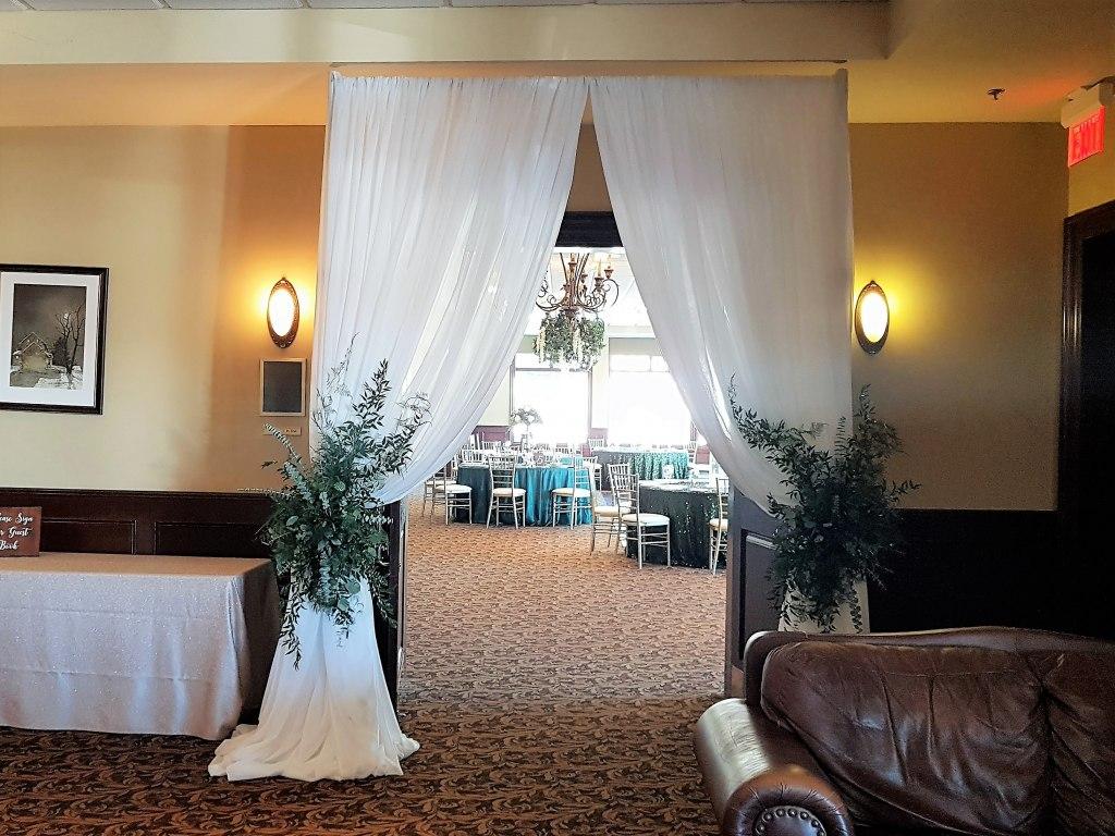 Window Drape Entranceway with Fresh Greenery Ties