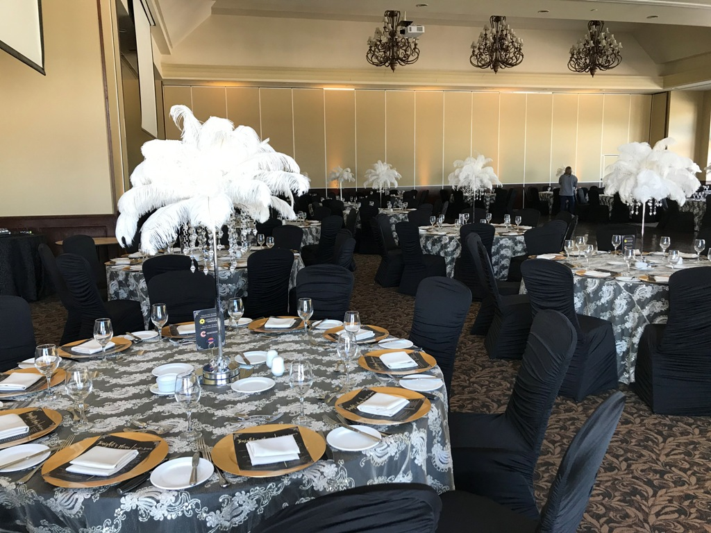 Feather Toppers on Silver Diamond Stands, GATSBY theme gold linens, Gold charger plates