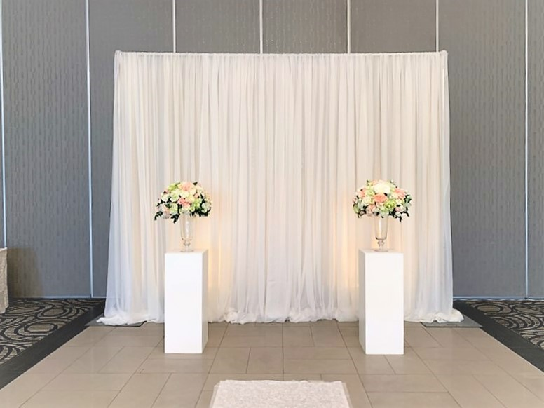 White Cube Pedestals with Footed Glass Vases and Silk Rental Arrangements
