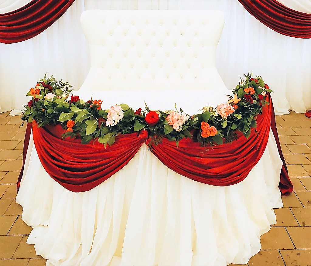 Crimson Red Valance over Pillowy Skirting with added Fresh Floral Garland