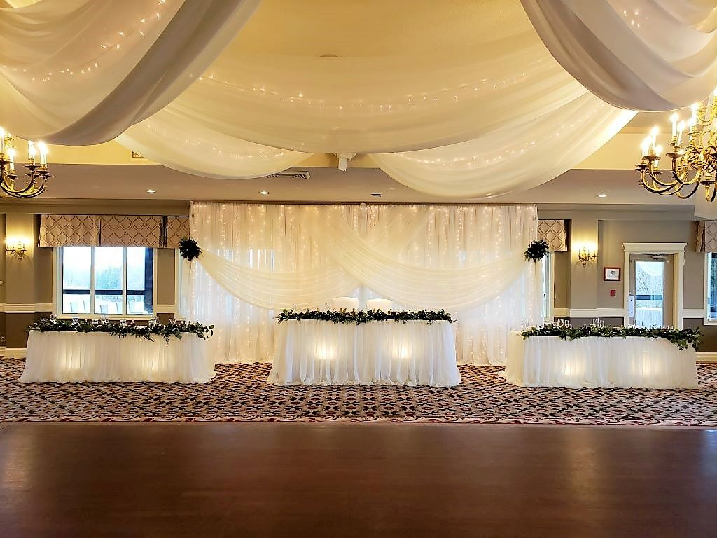 Head Table Decor with Fresh Garland & Pillowy Sheer Skirting with Underlighting