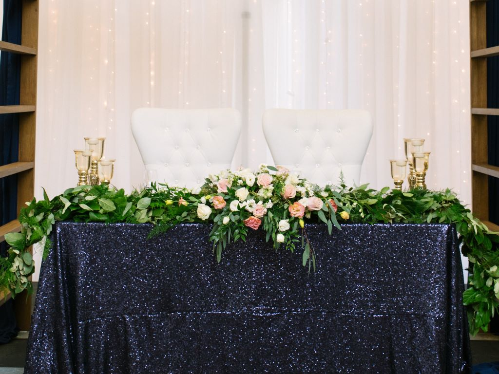 Navy Sequin Sweet Heart Table with Fresh Floral Garland & Bride & Groom Chairs